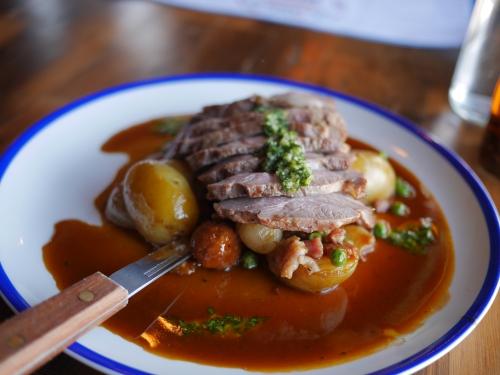 Lamb rump, pancetta, chorizo, Peas & baby onions with thyme roast potatoes
