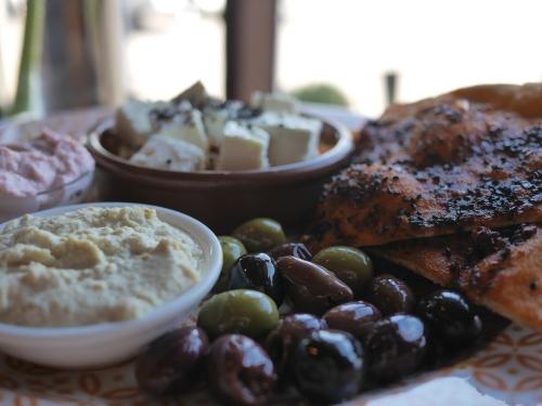 Mezze - Hummus, raita, olives, feta, taramasalata, harissa flatbread, rice & lentil salad