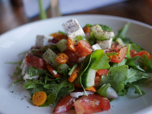 Plough greek salad, cape gooseberry, tomato, cucumber, feta & rocket with harissa almonds, honey & sumac dressing